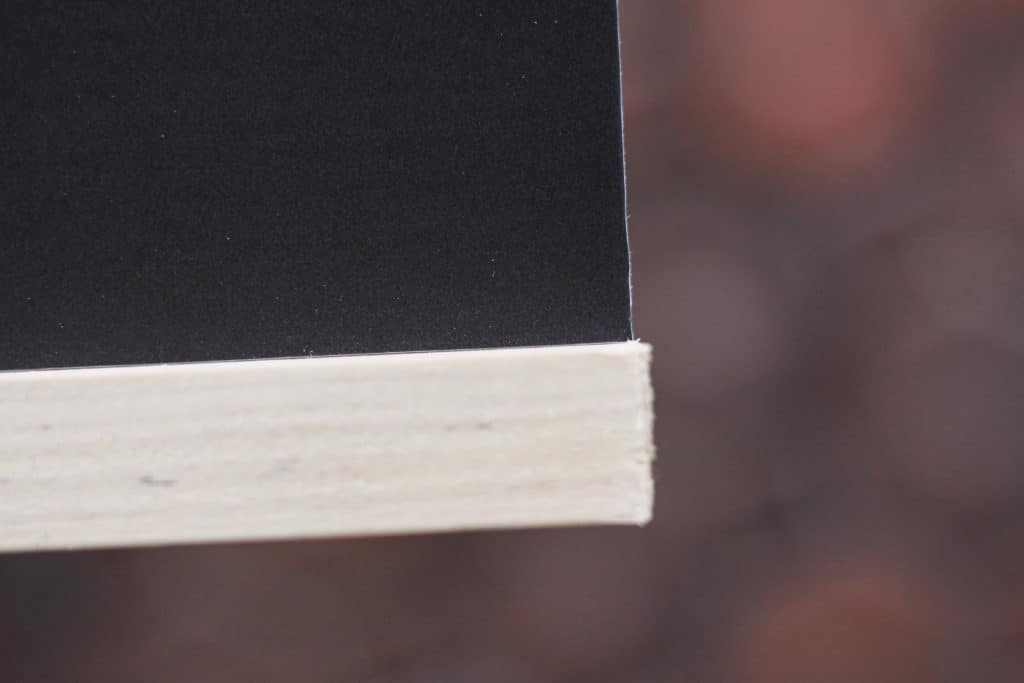 Closeup of flush end of artwork frame