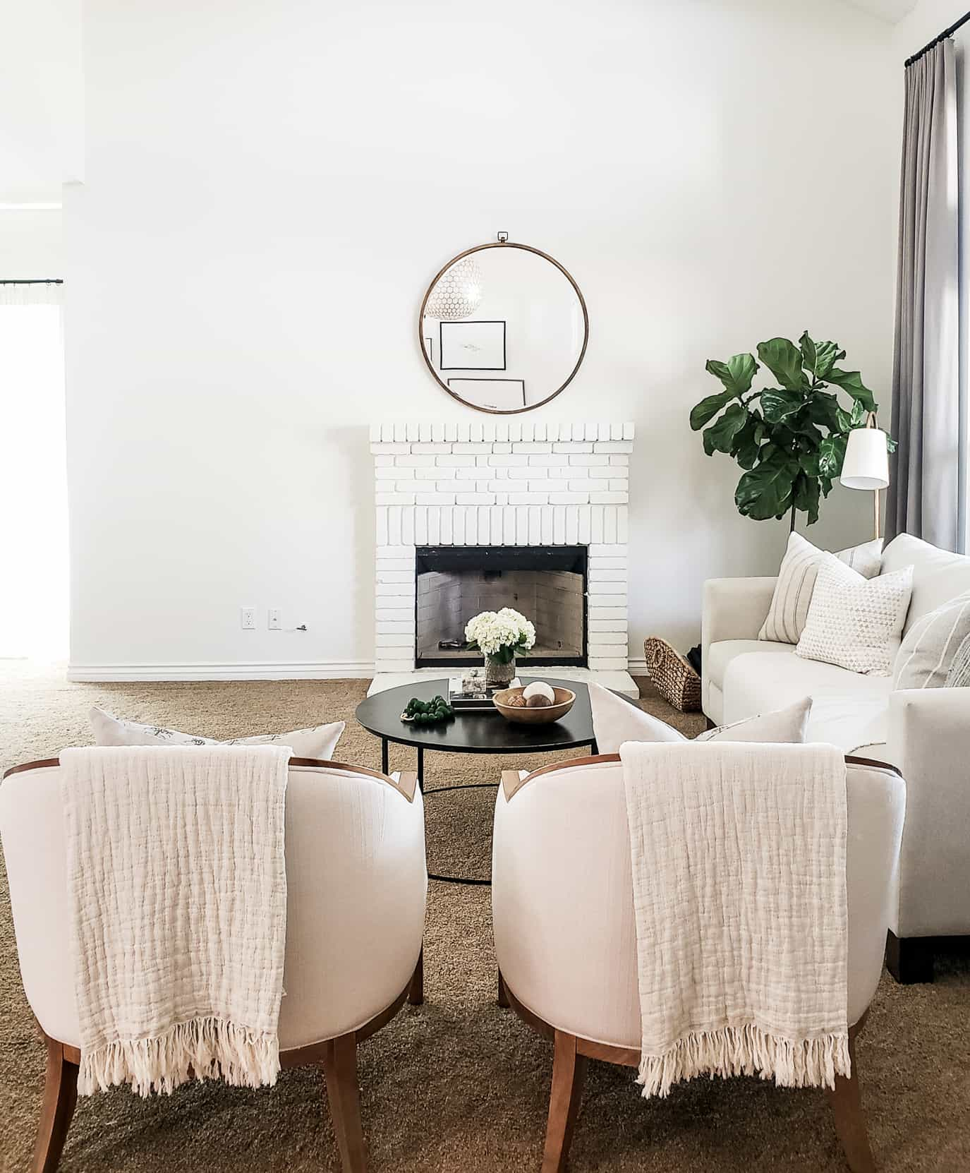 formal living room with blank fireplace wall