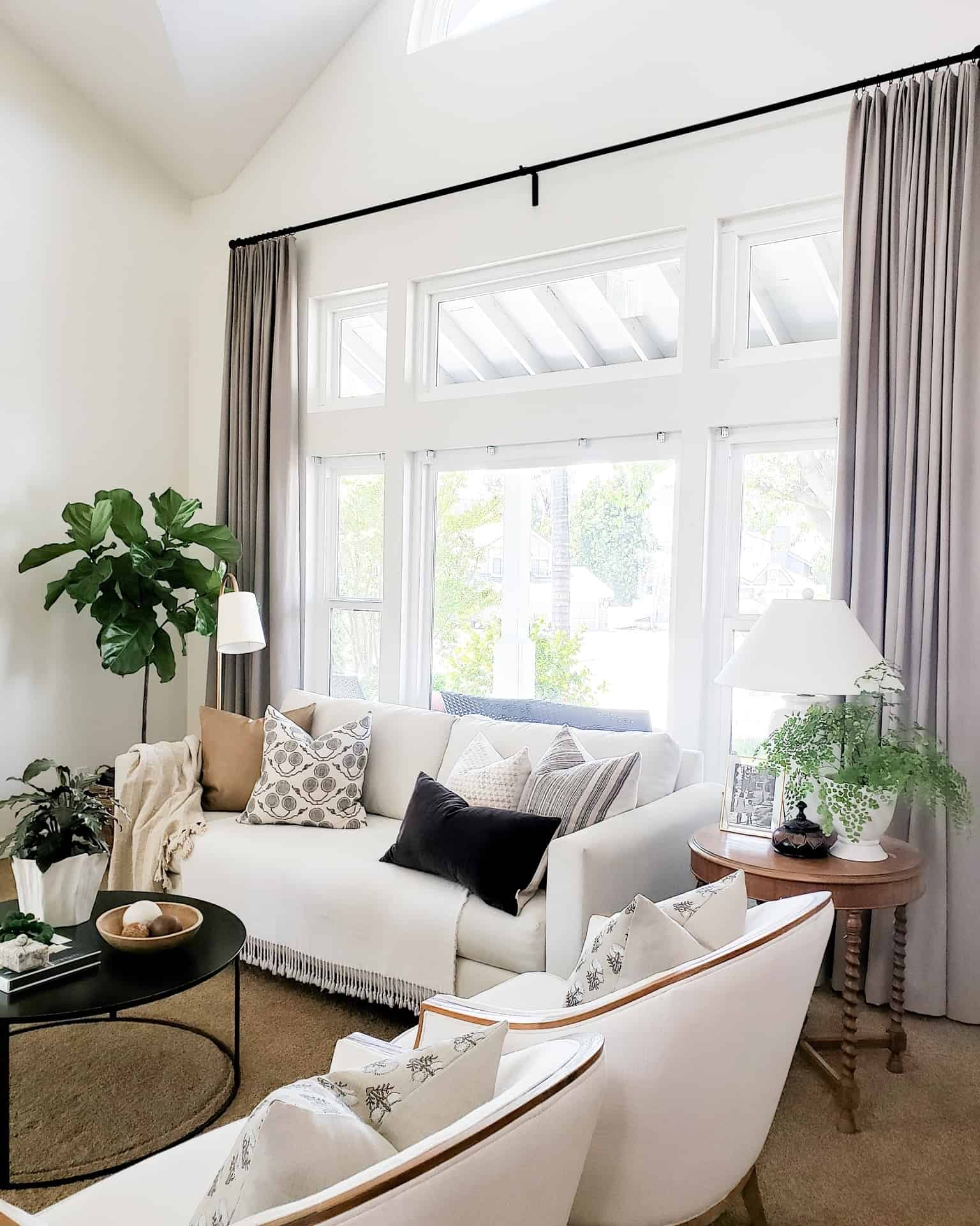 white living room with brown drapes and white furniture love your home while waiting to renovate