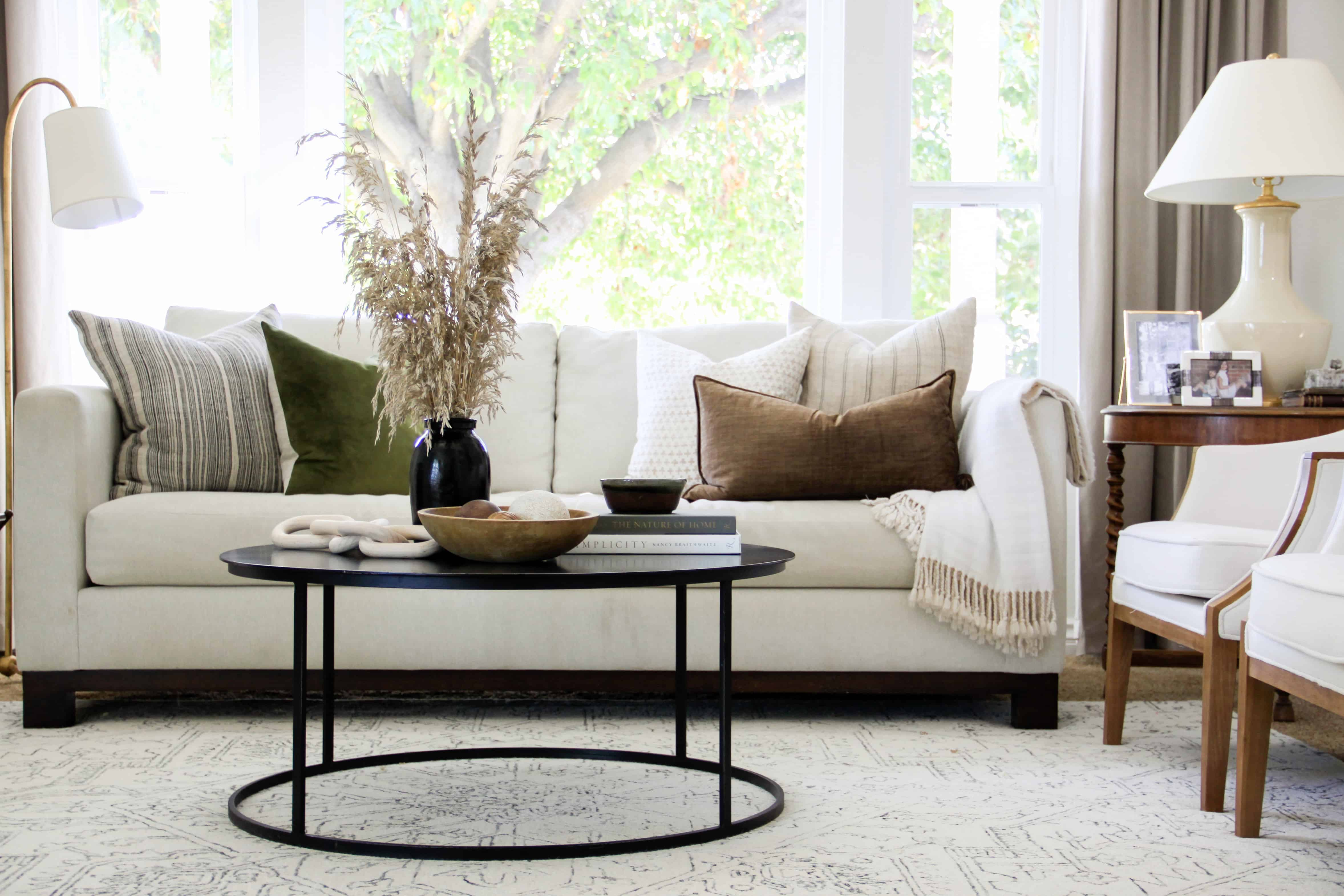 formal living room with white rug