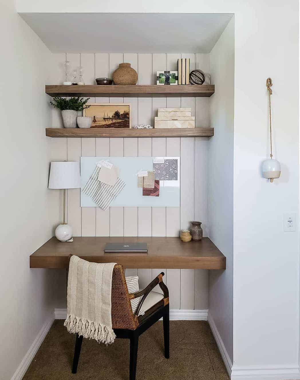 built in wooden desk and floating shelves with chair