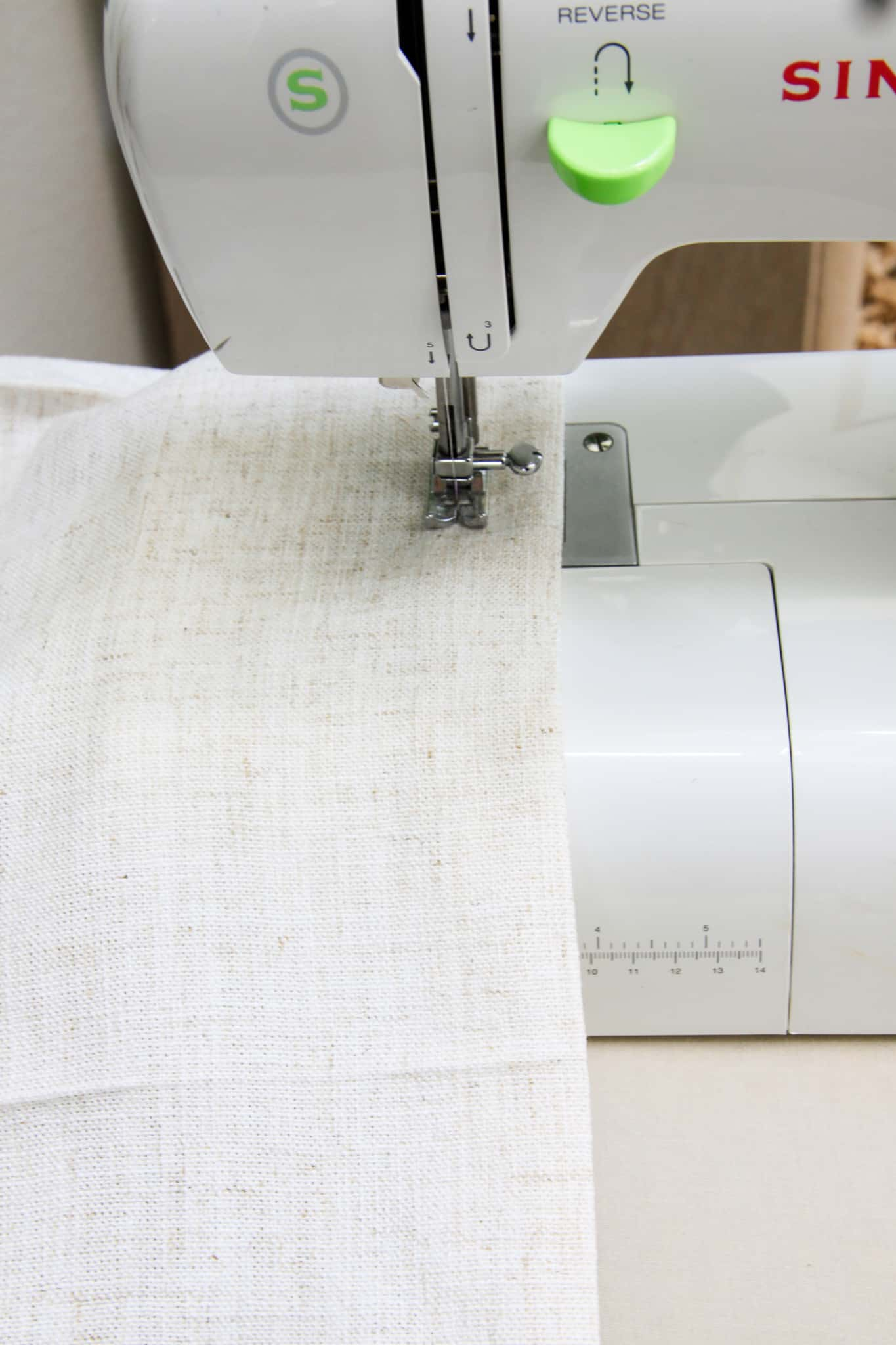 fabric being sewn on a sewing machine