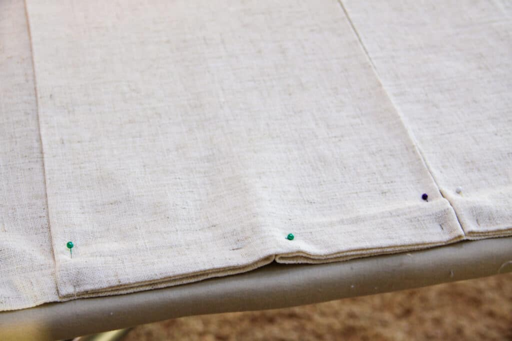 box pleat in fabric with pins in it