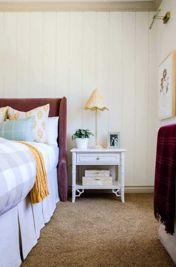 picture of girls' bedroom with white nightstand and velvet headboard