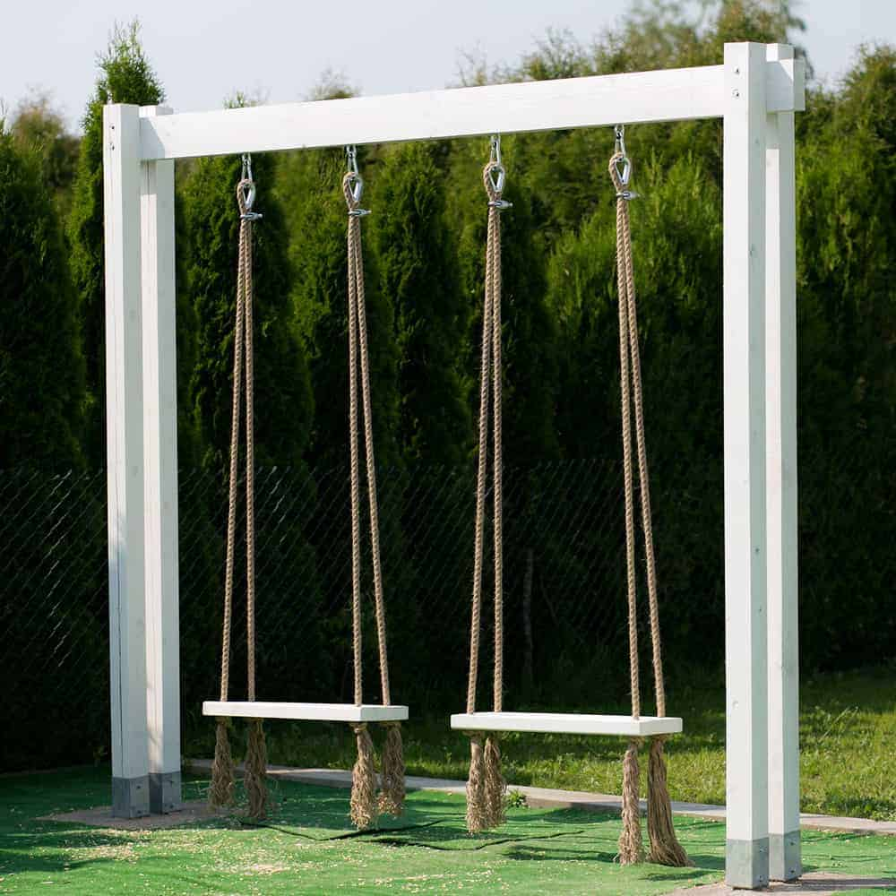 two wooden swings on ropes