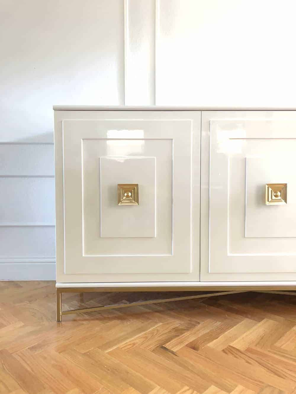 creamy lacquered chest on herringbone wood floor