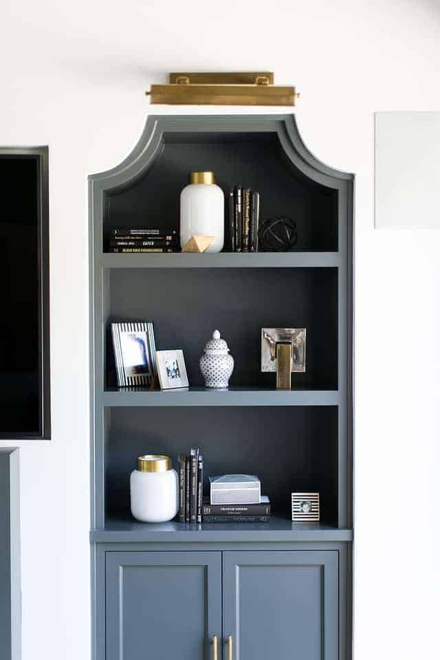 dark gray recessed shelving unit