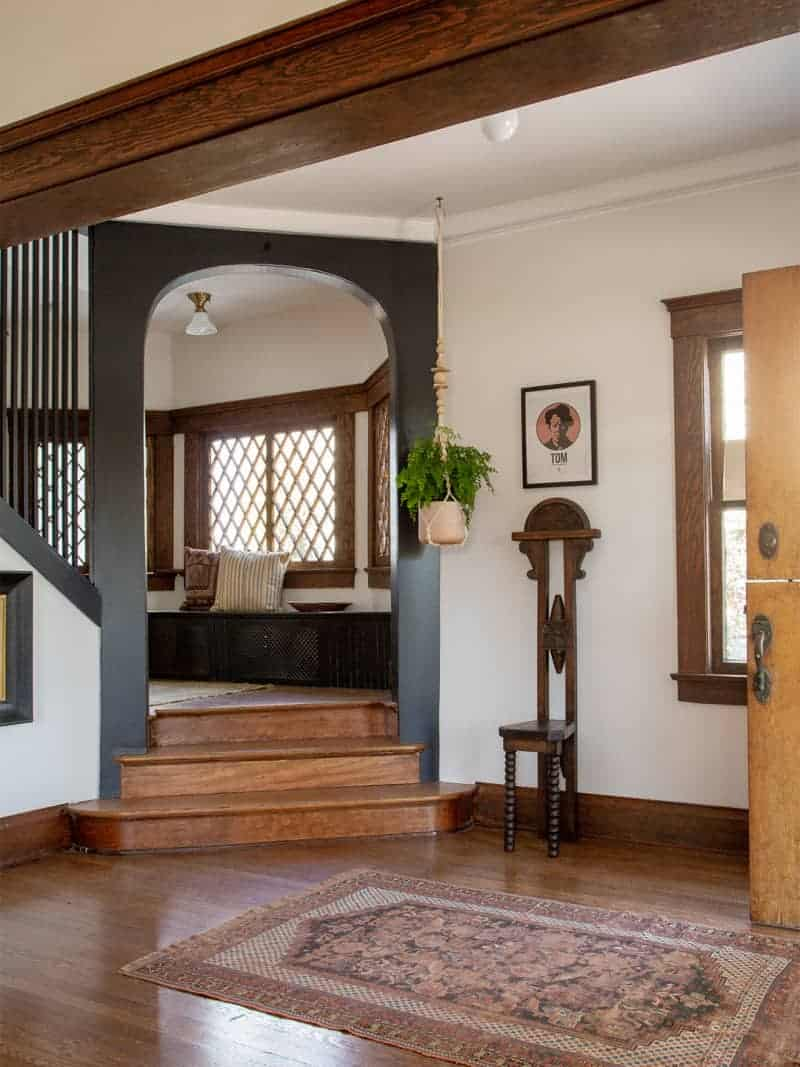 entry way of renovated LA home with black arch