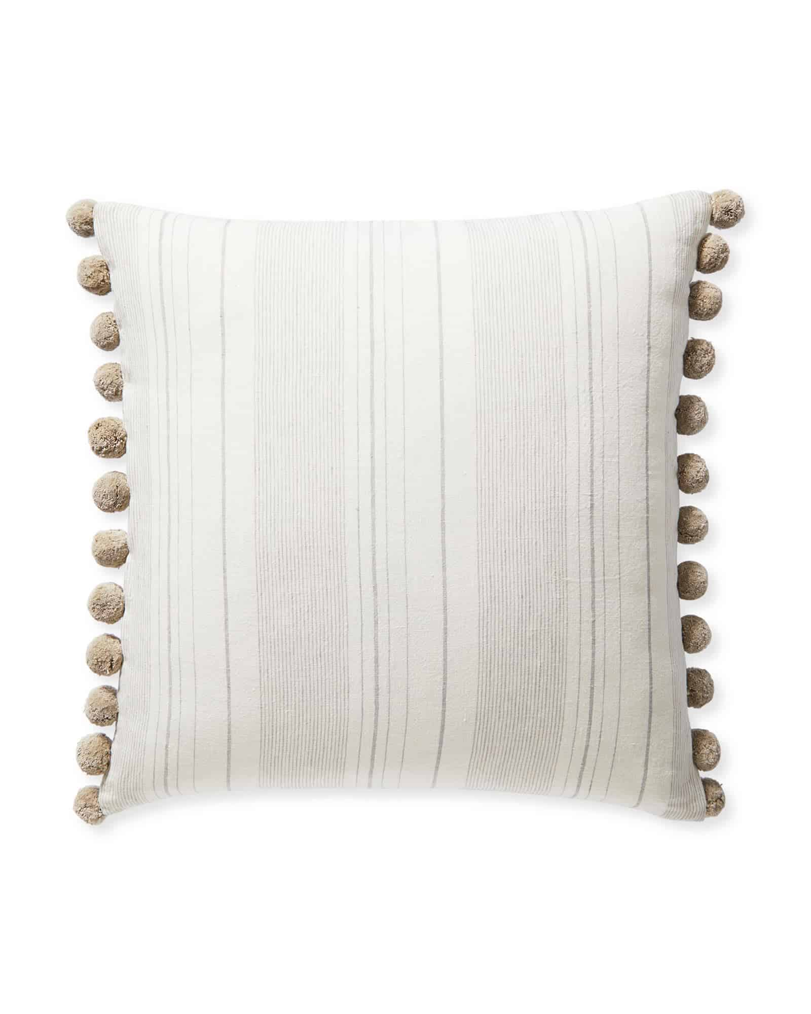 neutral striped pom pom pillow