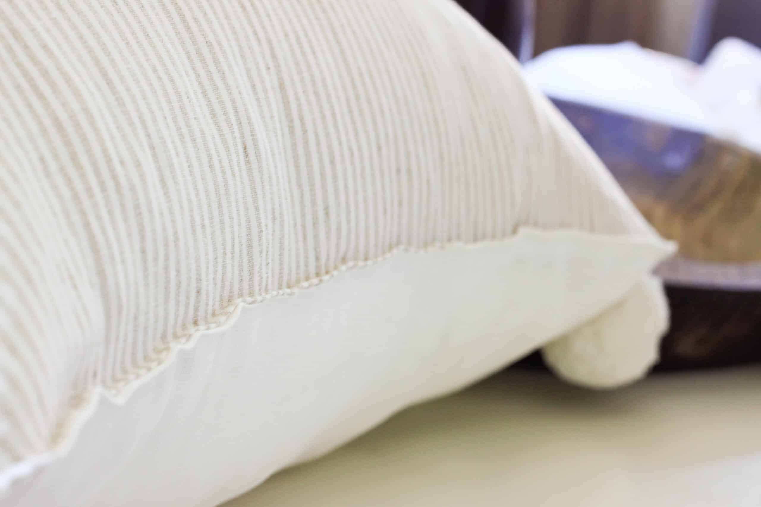 sewn seam of pin stripe pillow cover
