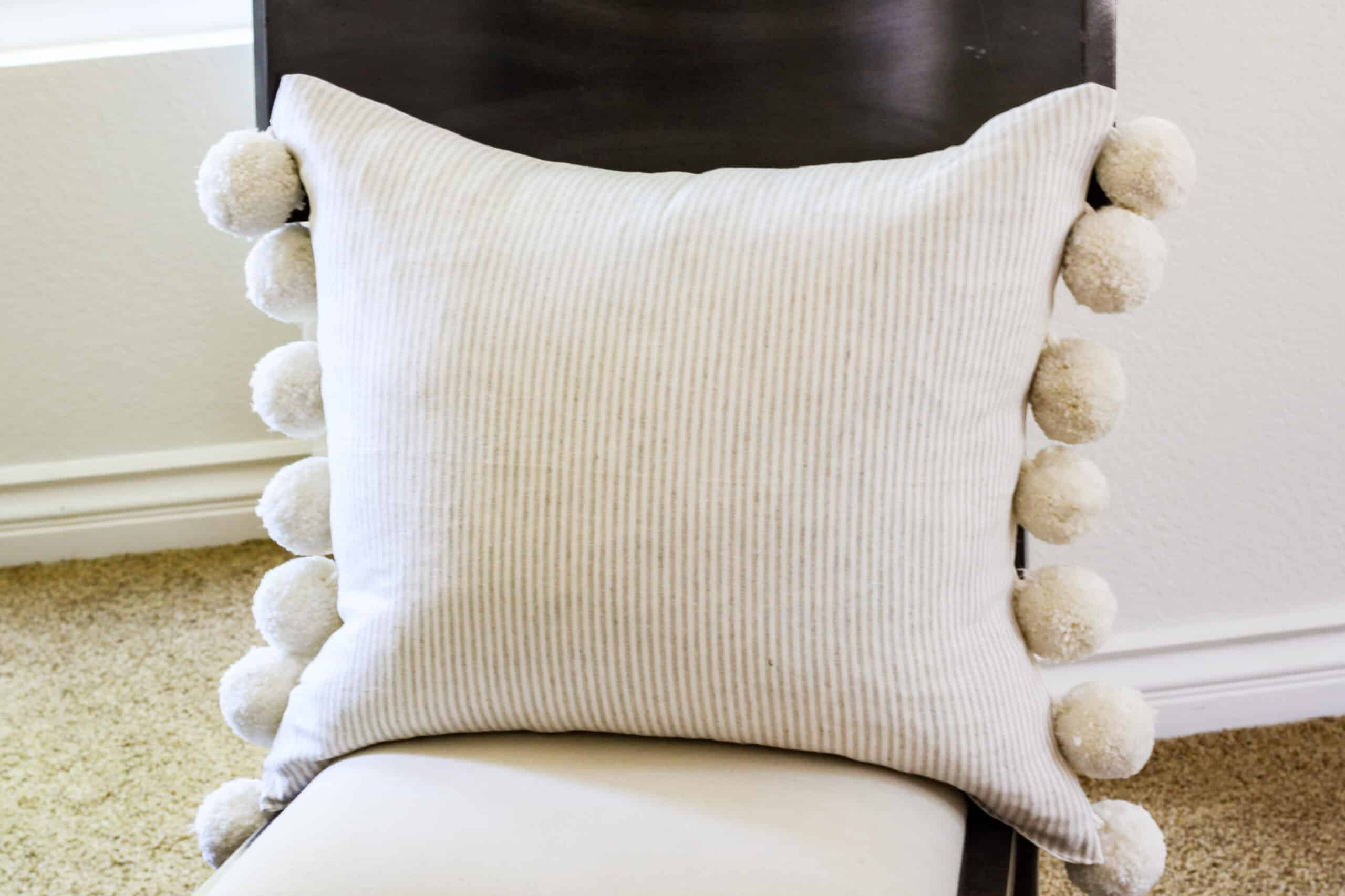 finished pin stripe pom pom pillow