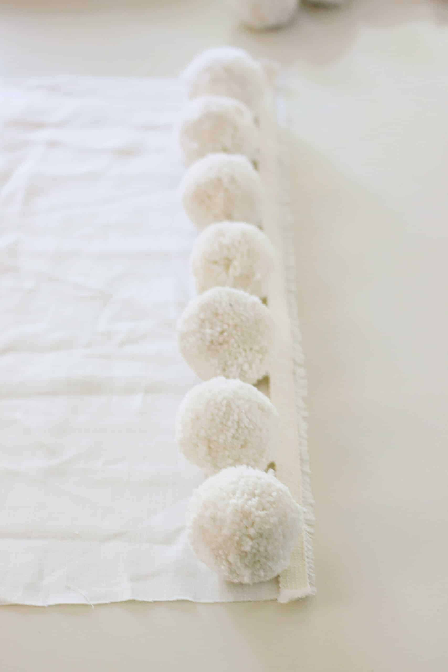 neutral oversized pom pom trim