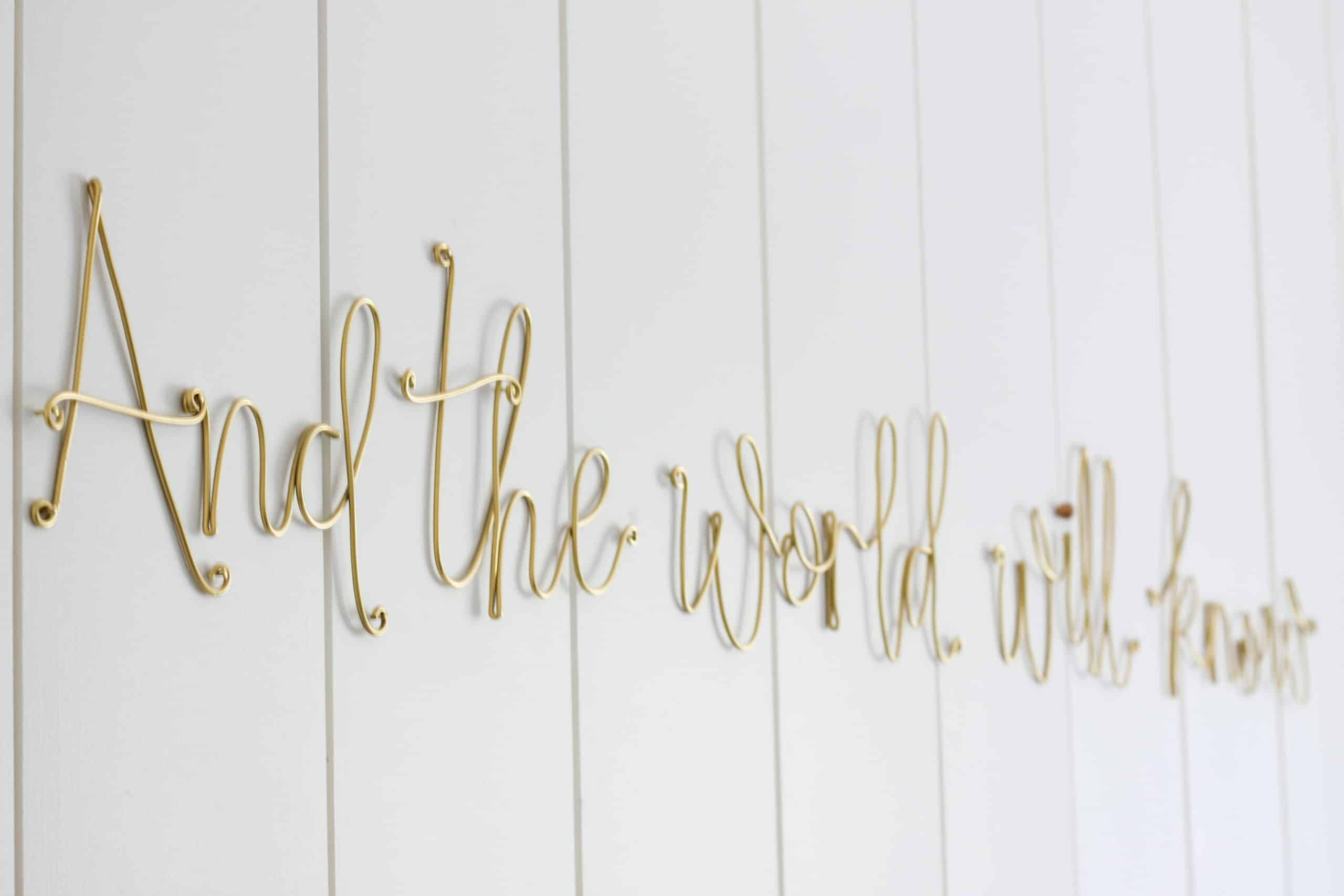 gold wire lettering on vertical shiplap wall