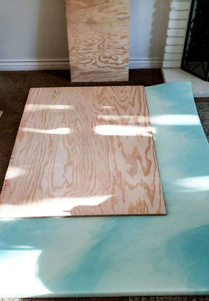 piece of plywood sitting on top of blue foam