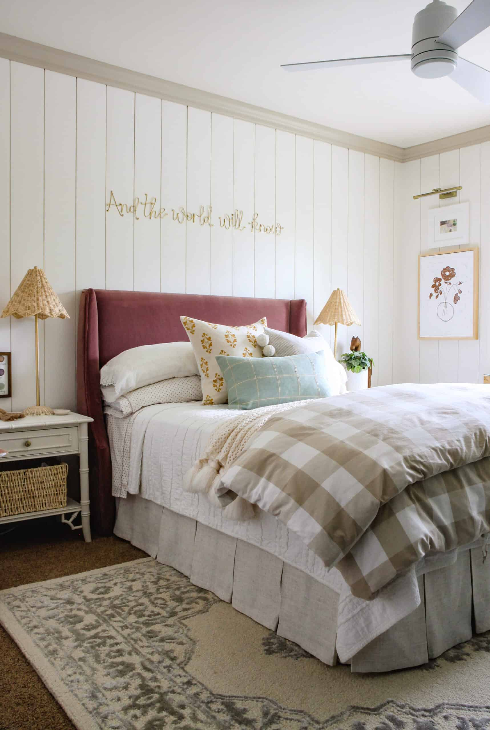 girls bedroom with white vertical shiplap, velvet headboard, and plaid duvet cover