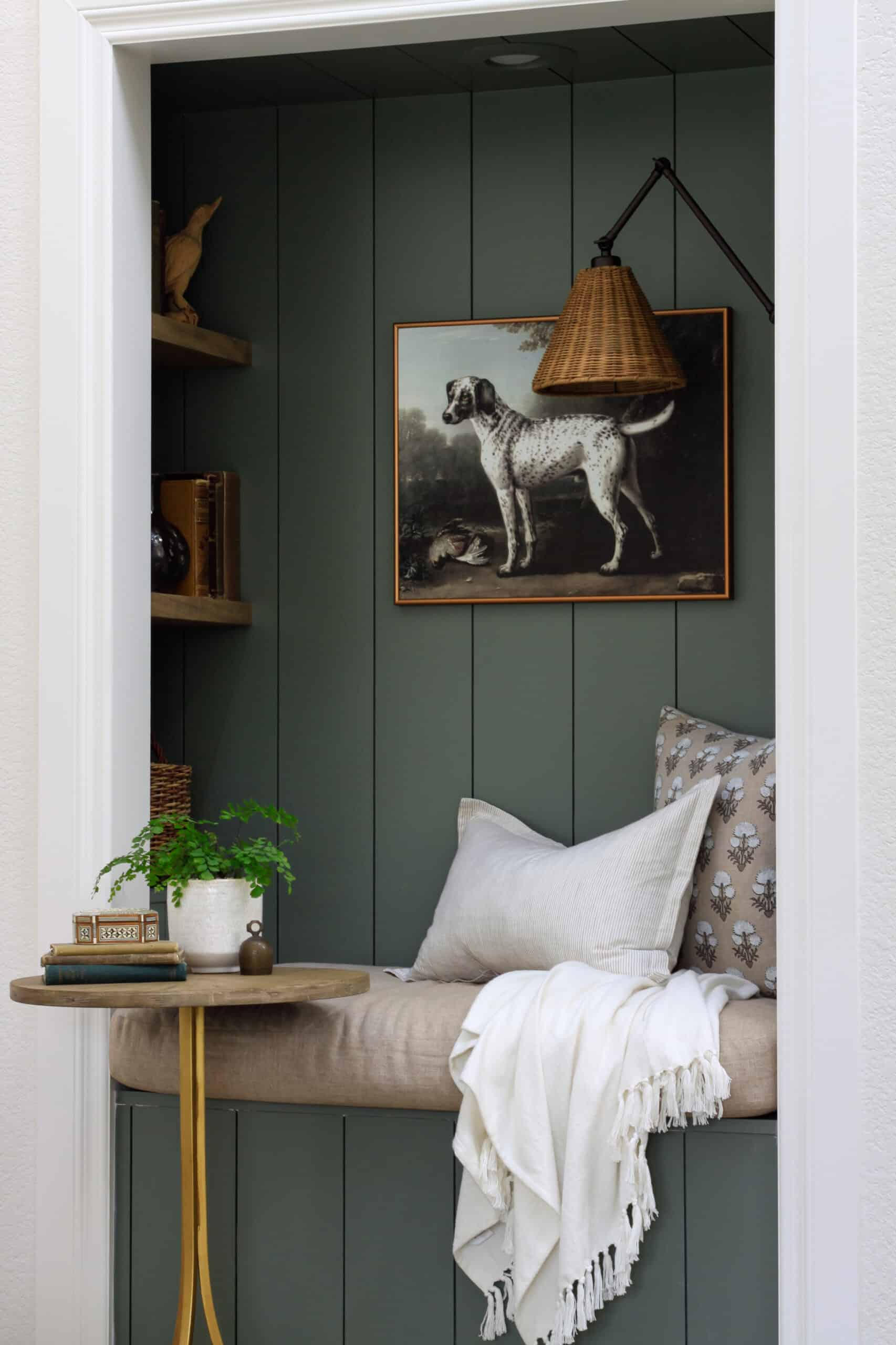 built in green shiplap reading nook with dalmatian art