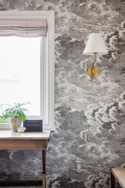 storm cloud wallpaper with brass sconce love letter design to husband