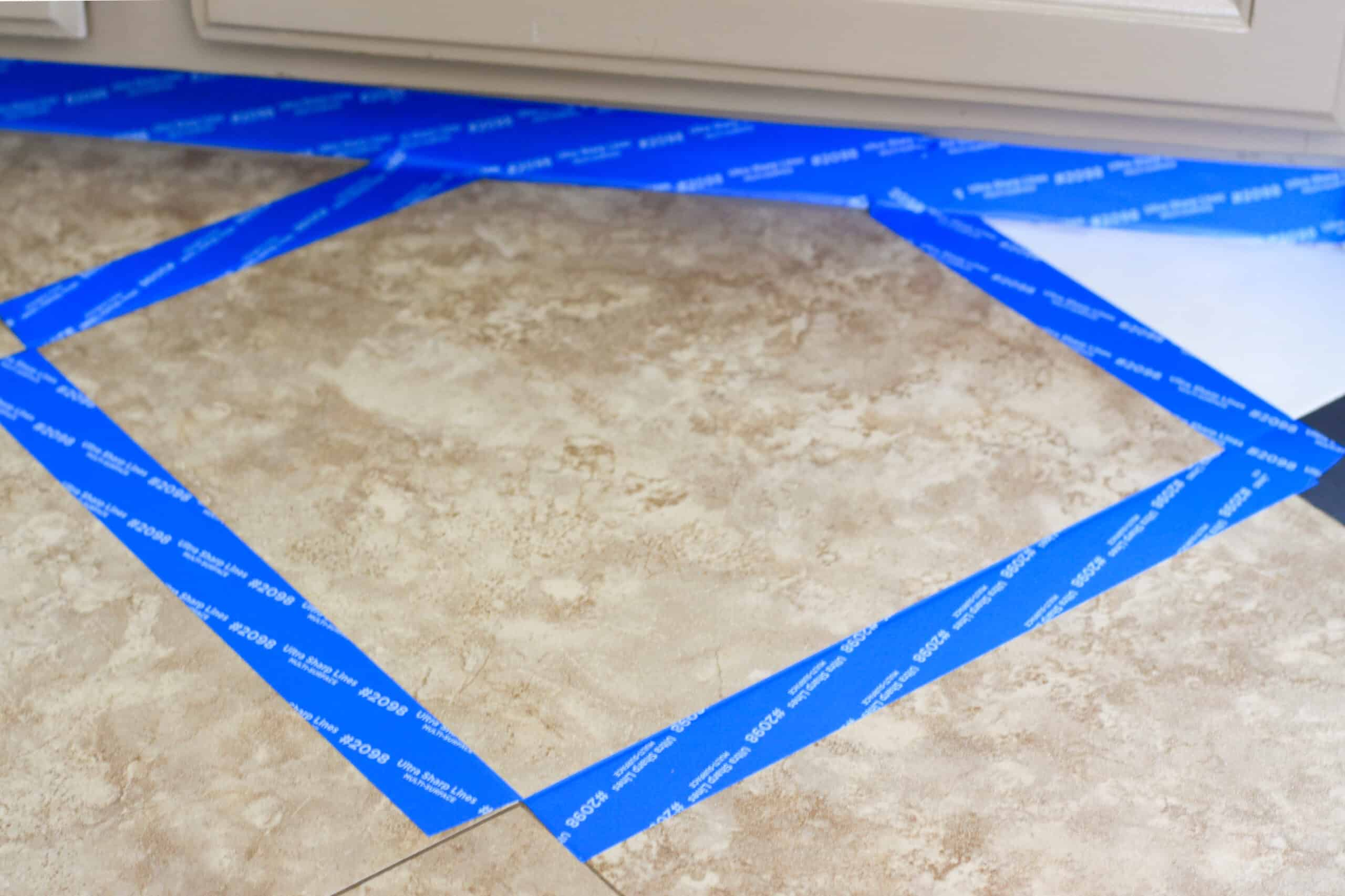 brown tile floors with blue painters tape