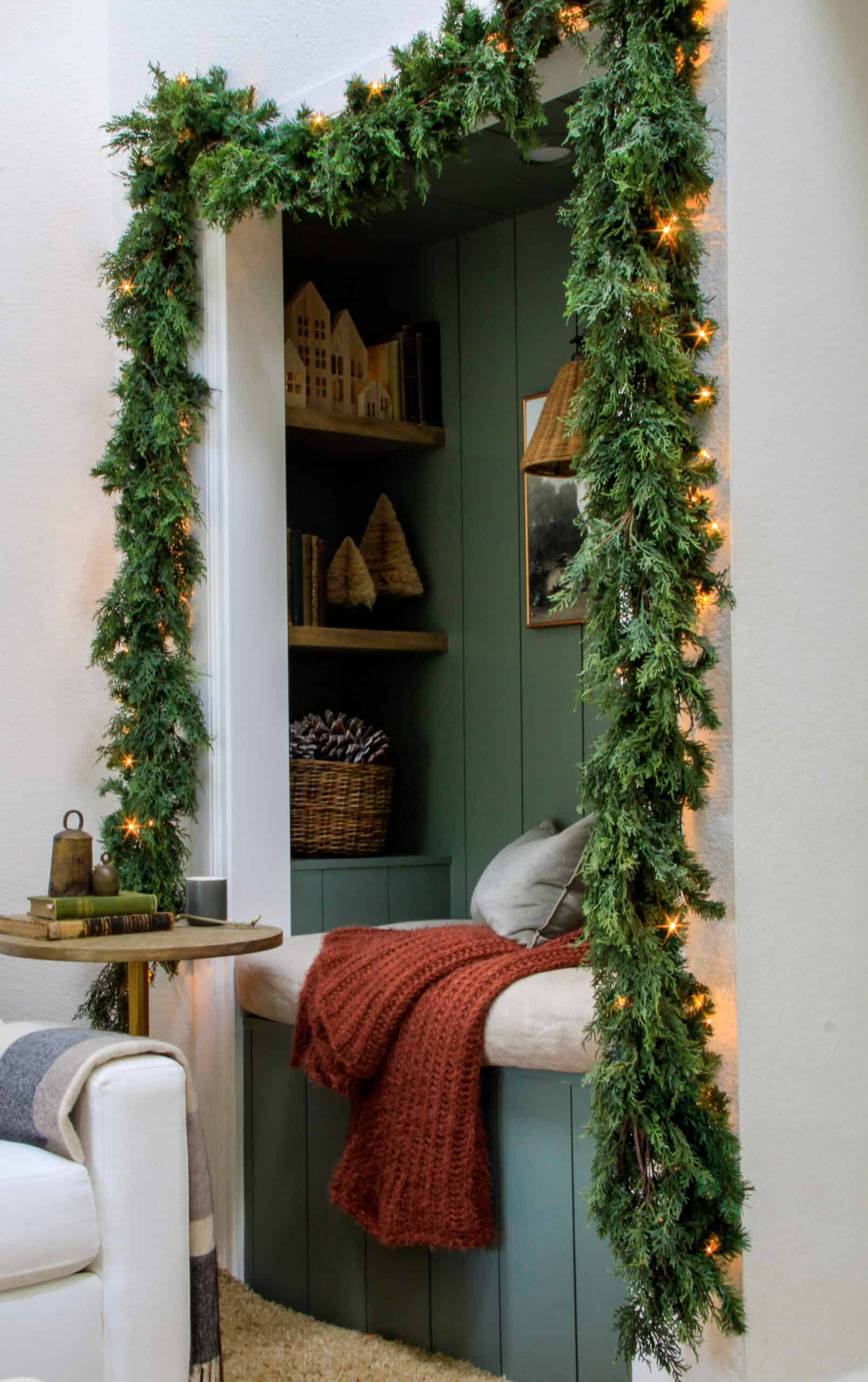 cozy reading nook with christmas garland