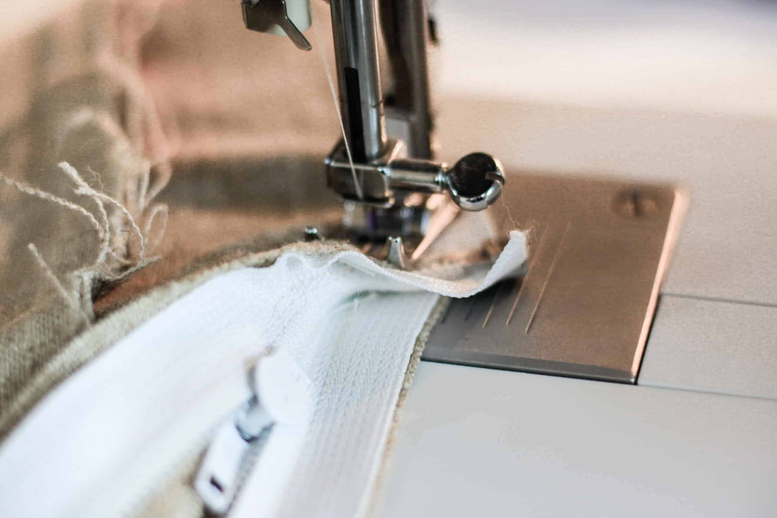zipper on sewing machine being sewn