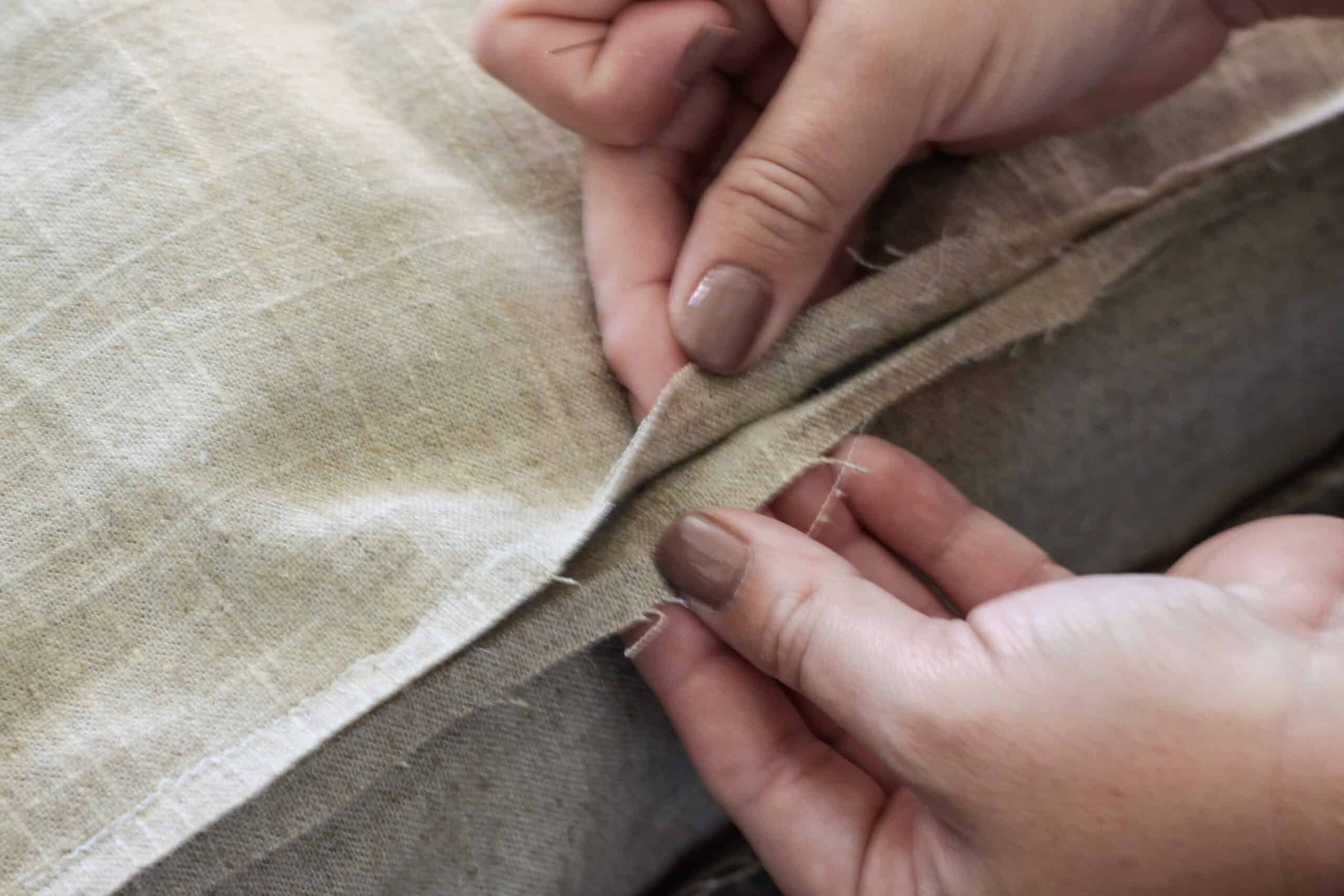 Hands holding brown fabric