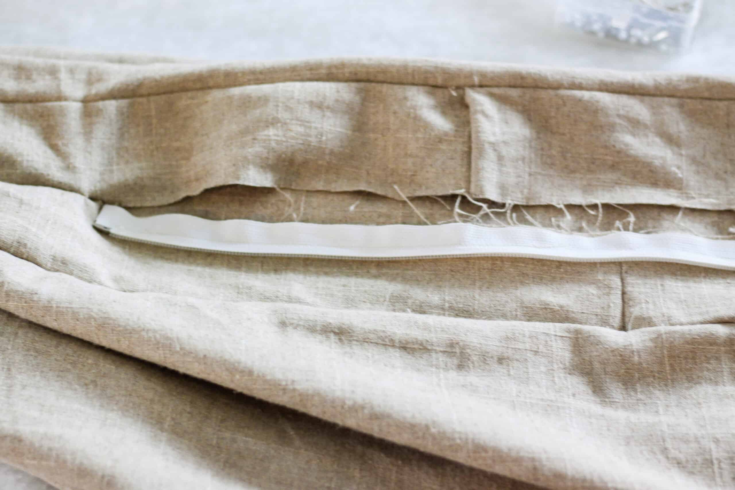 zipper pinned to inside of bench cushion cover
