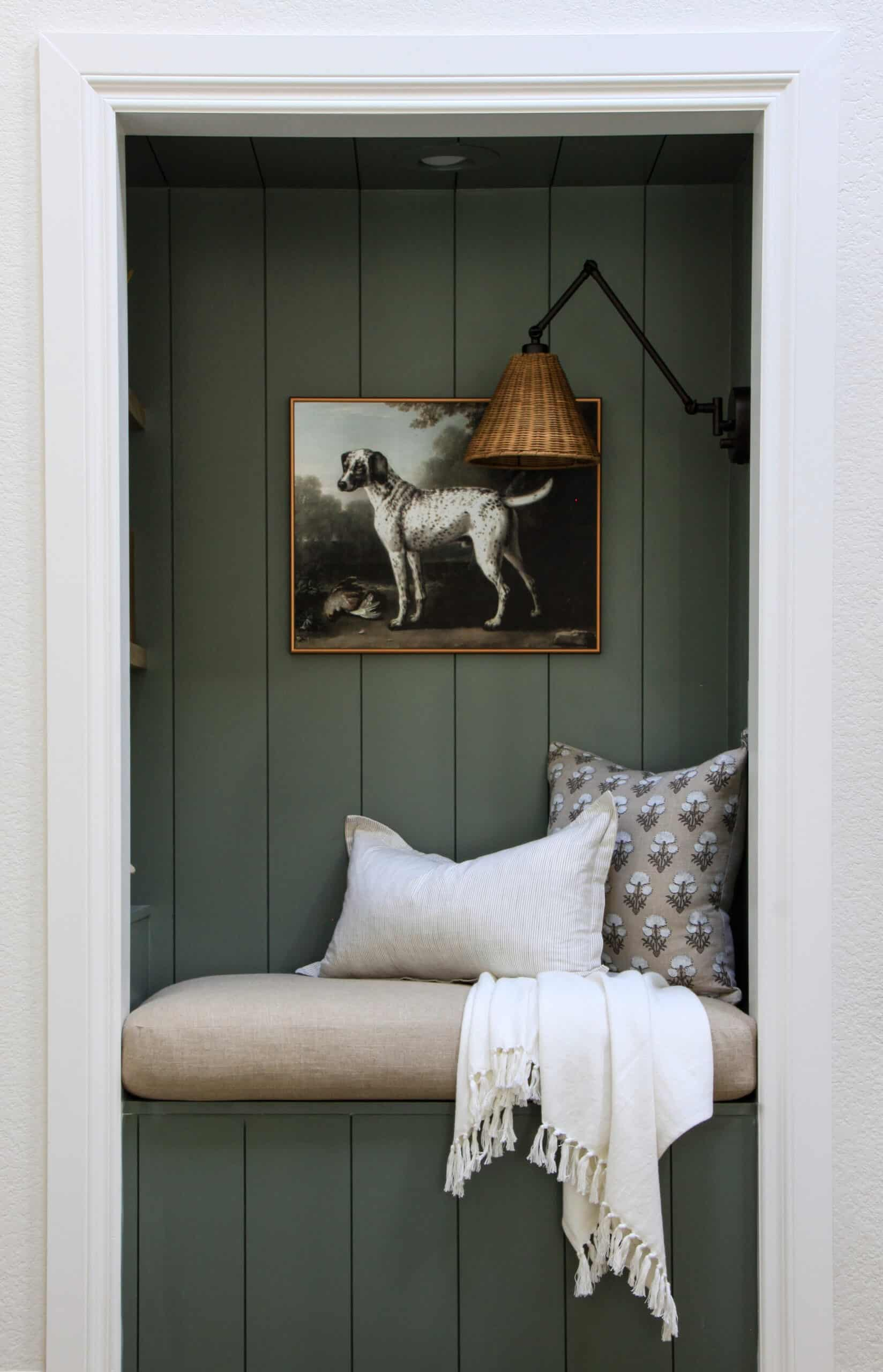 green reading nook with overstuffed bench cushion