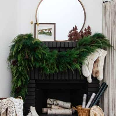 Black Brick Fireplace with Christmas Greenery