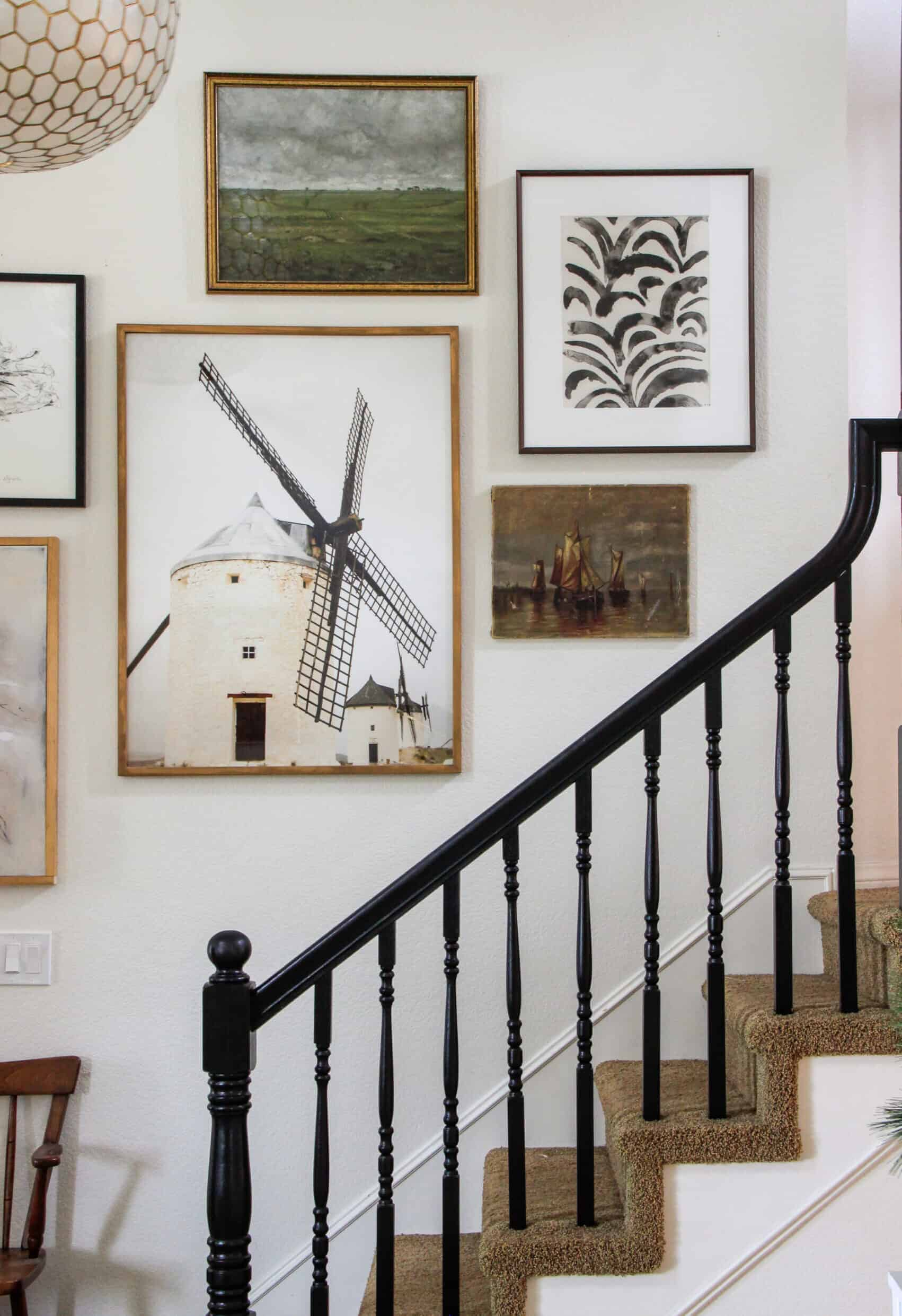 Gallery Wall with black banister and windmill art