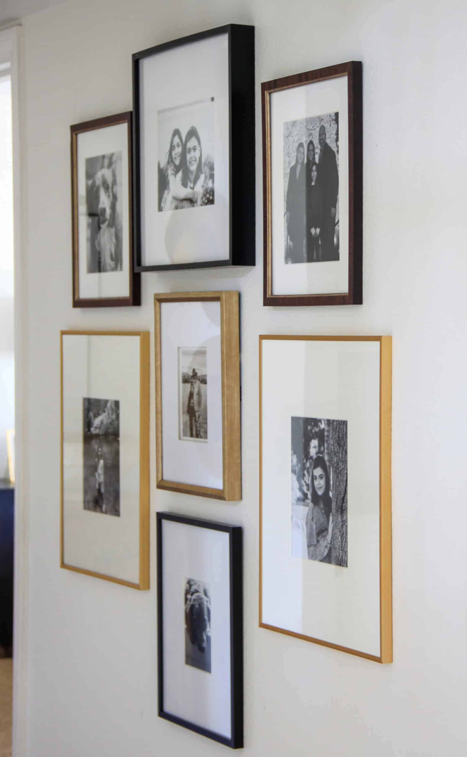 black and white family gallery wall