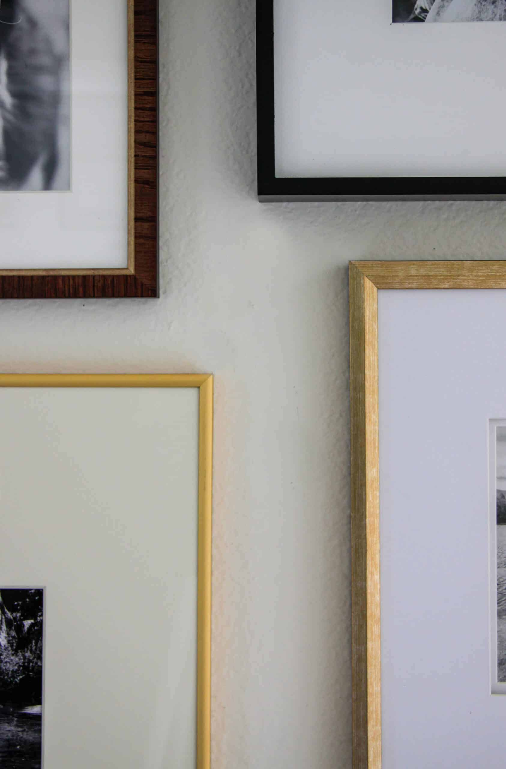close up of gold and black and wood frames