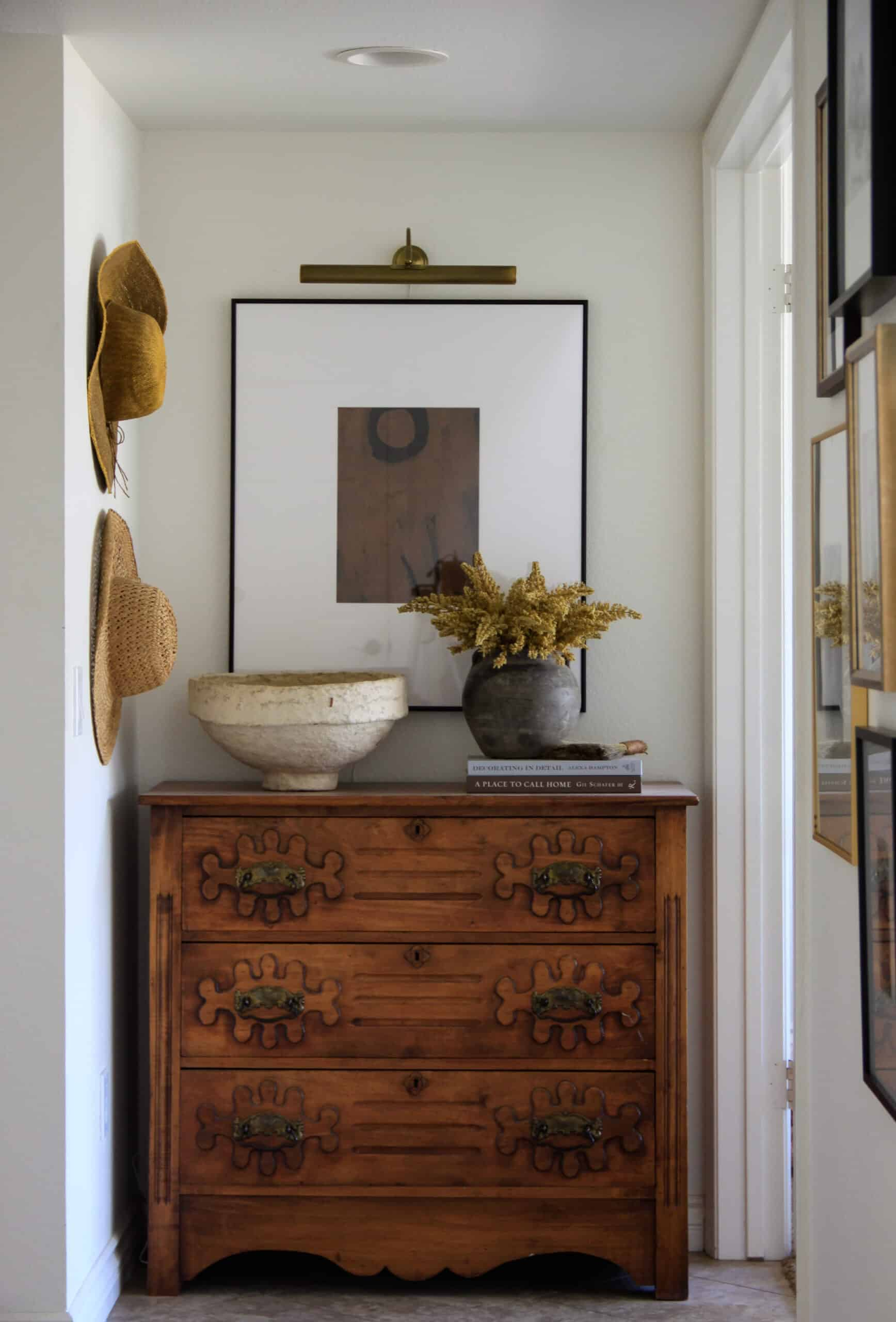 hallway with antique chest and gallery wall