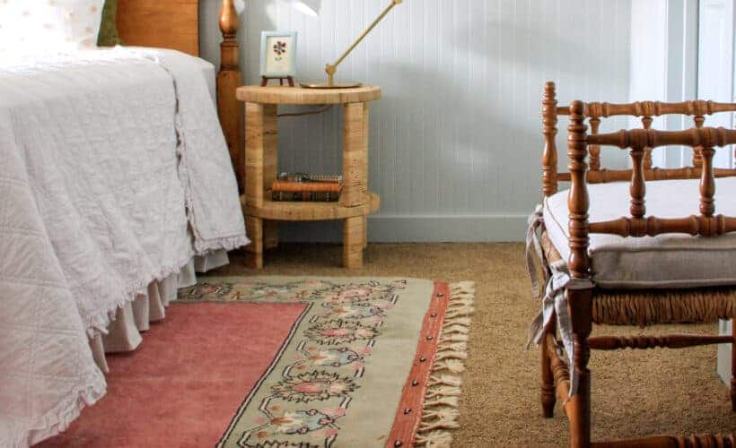 Blue girls' bedroom with vintage rug