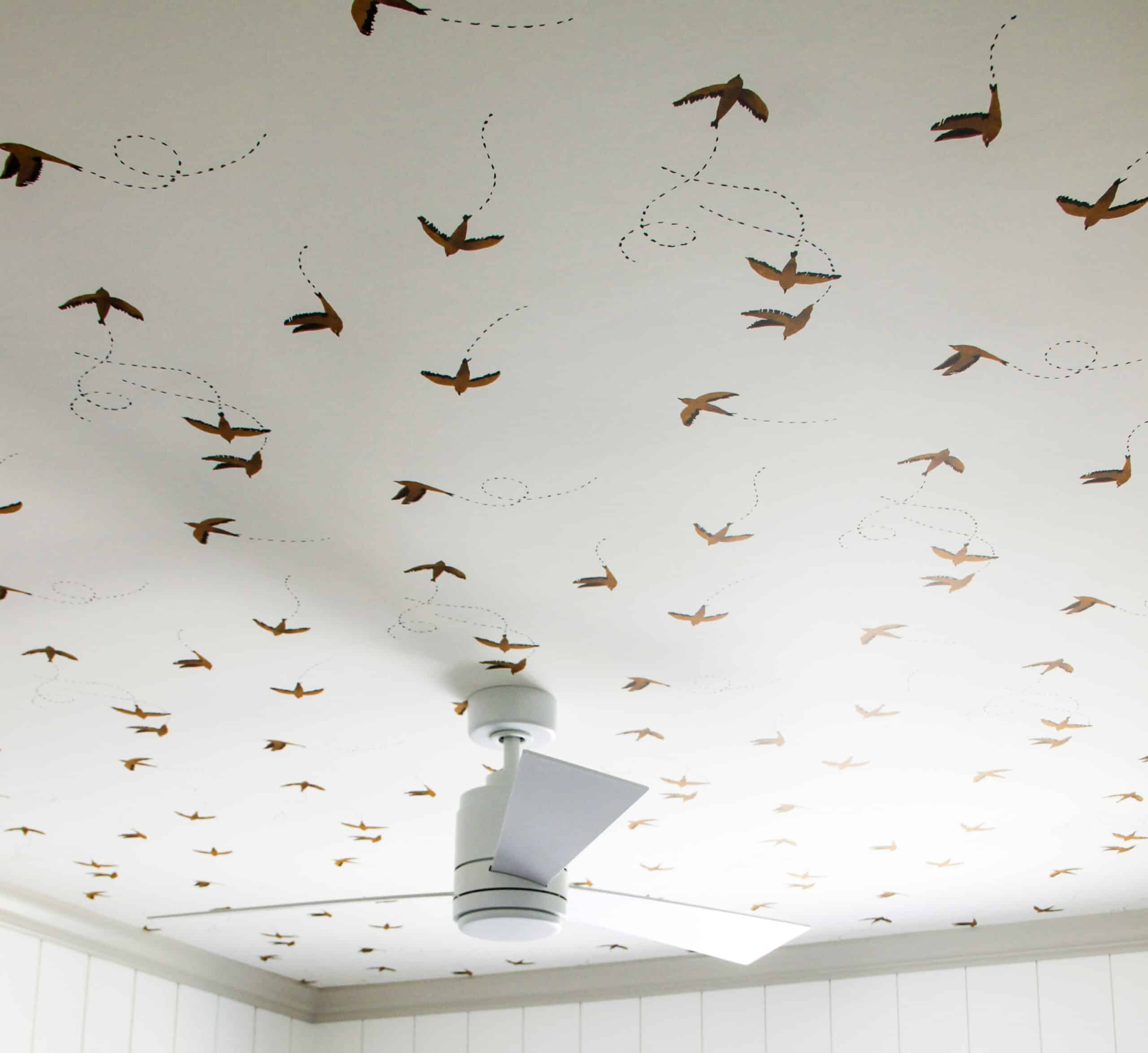 Wallpapered bedroom ceiling with fan