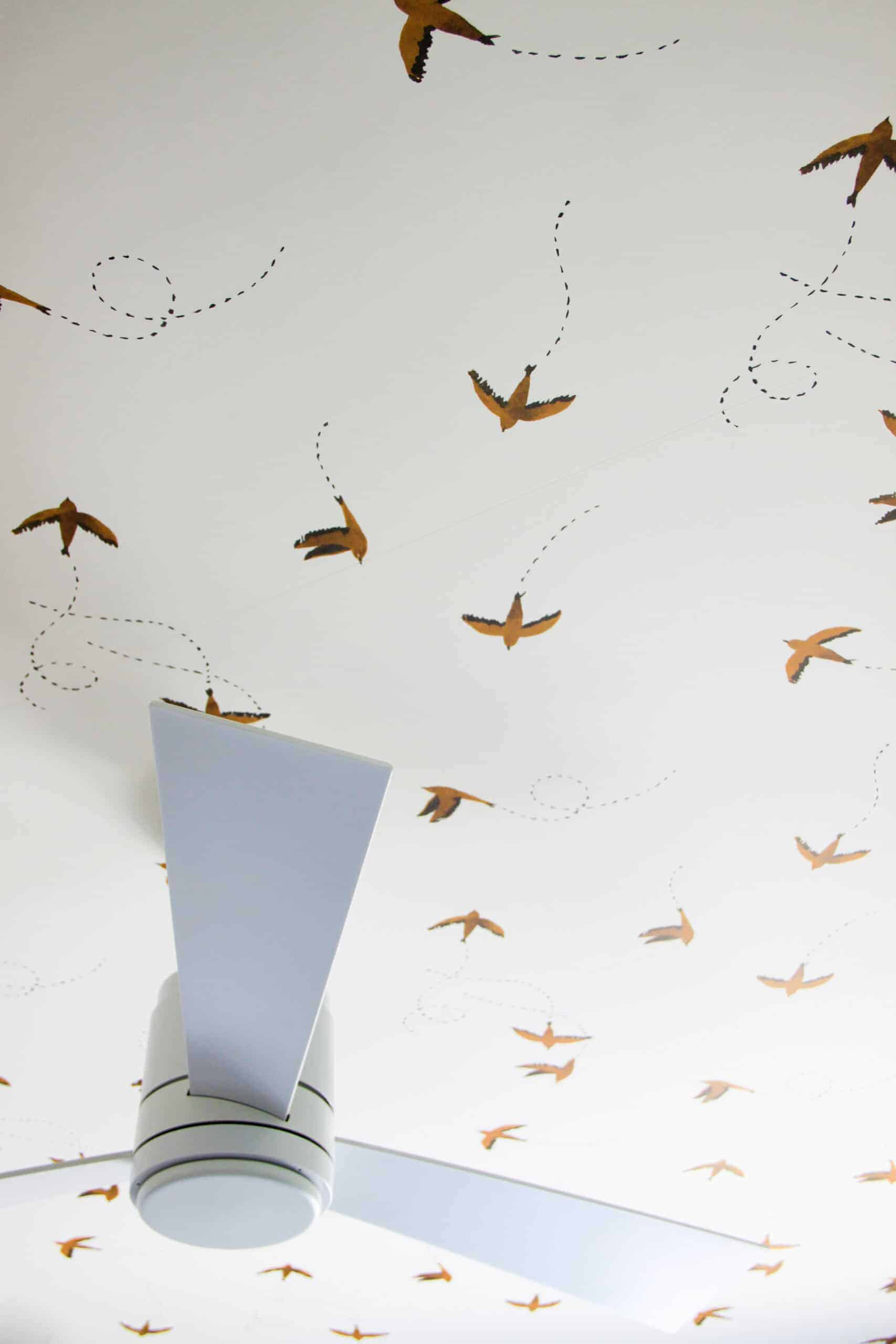 closeup of swallow wallpapered bedroom ceiling