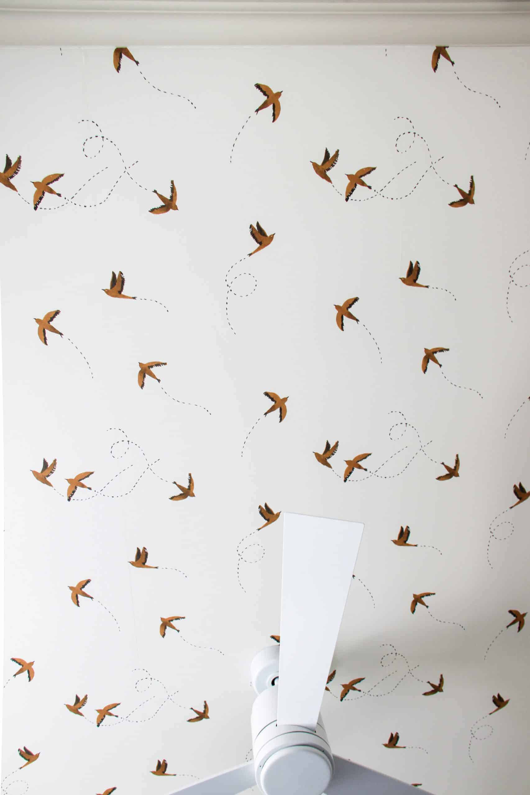 overhead view of swallow wallpapered bedroom ceiling