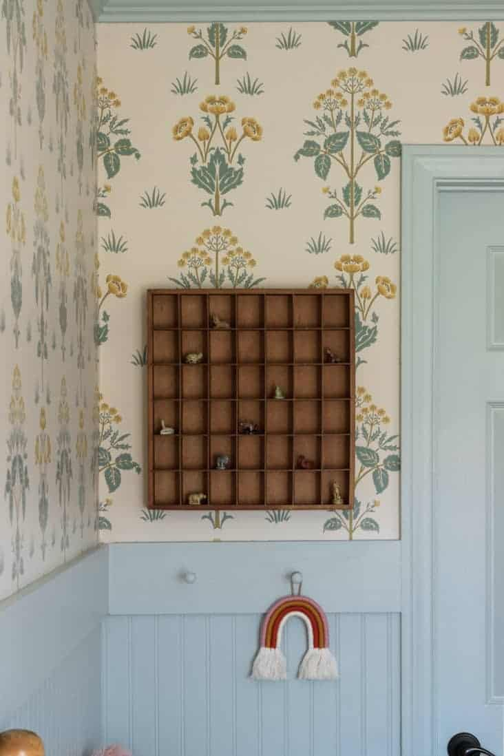 wallpaper with blue trim and printer's drawer