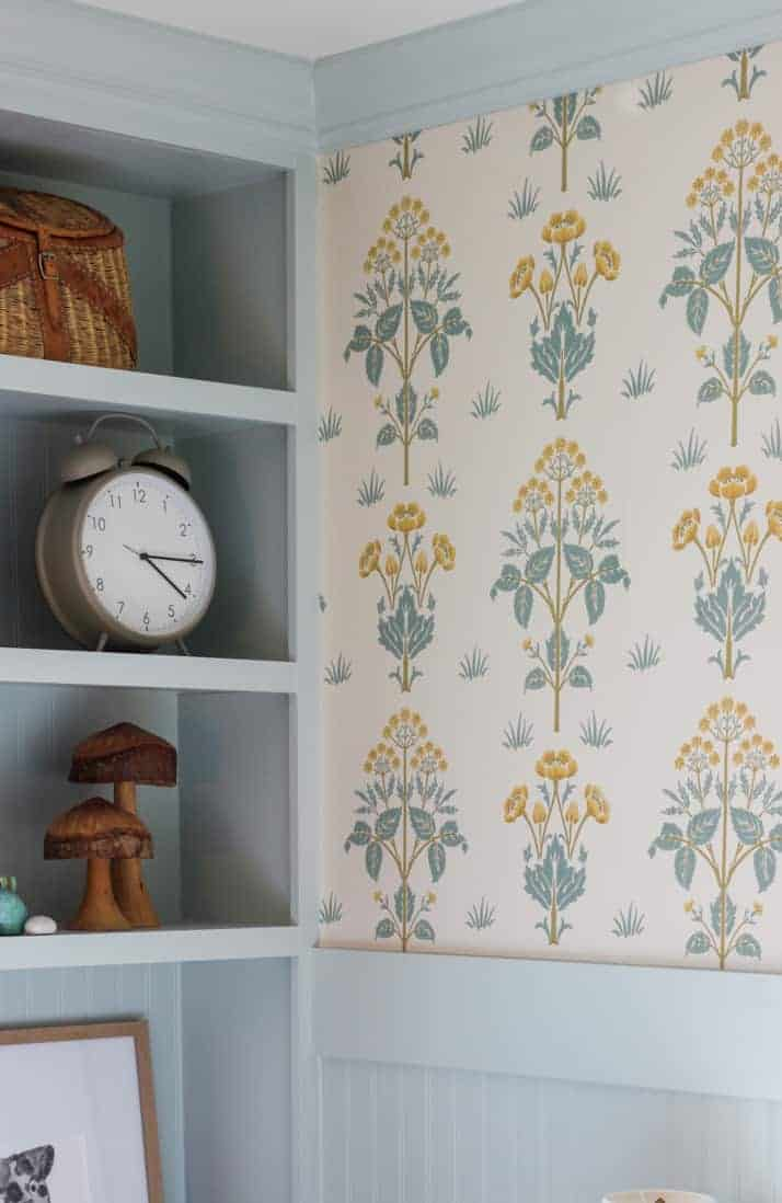 blue built-ins with English cottage wallpaper