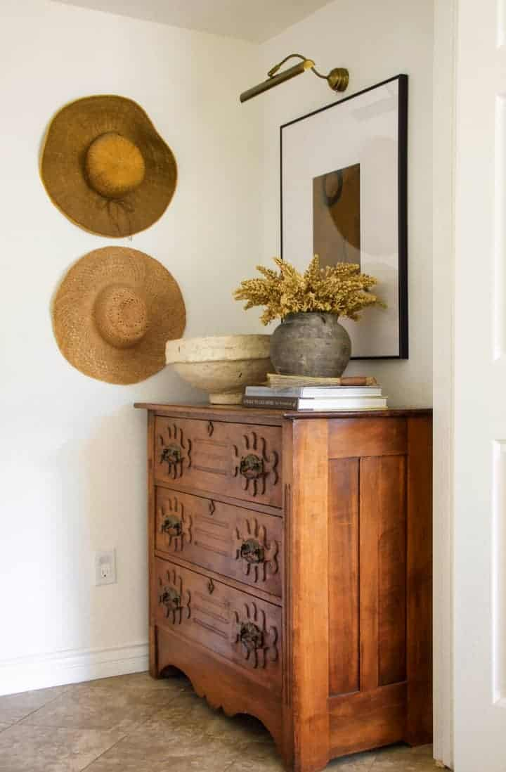 vintage chest of drawers with art and sun hats
