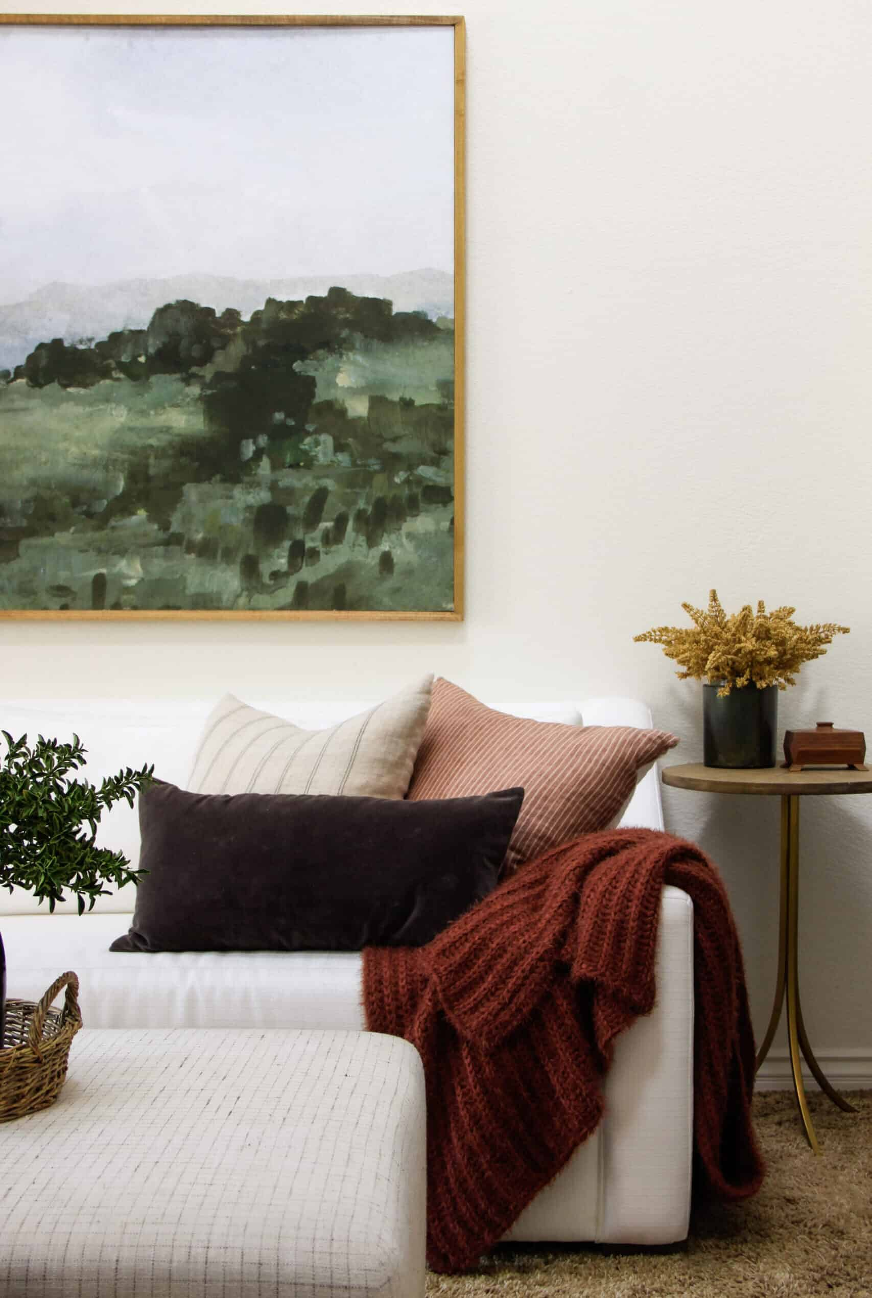 white sofa with framed art above