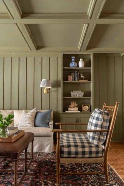 olive green paneled room with blue checkered chair