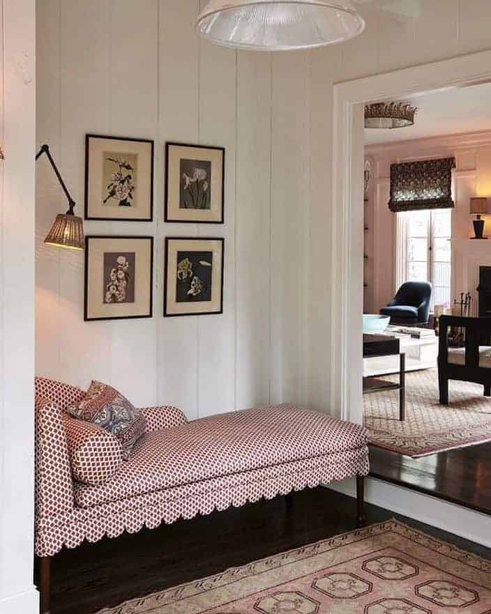 chaise with scallop trim and sconce above