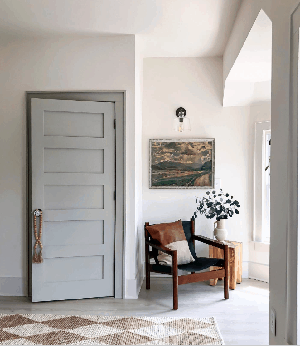 leather chair beside painted door