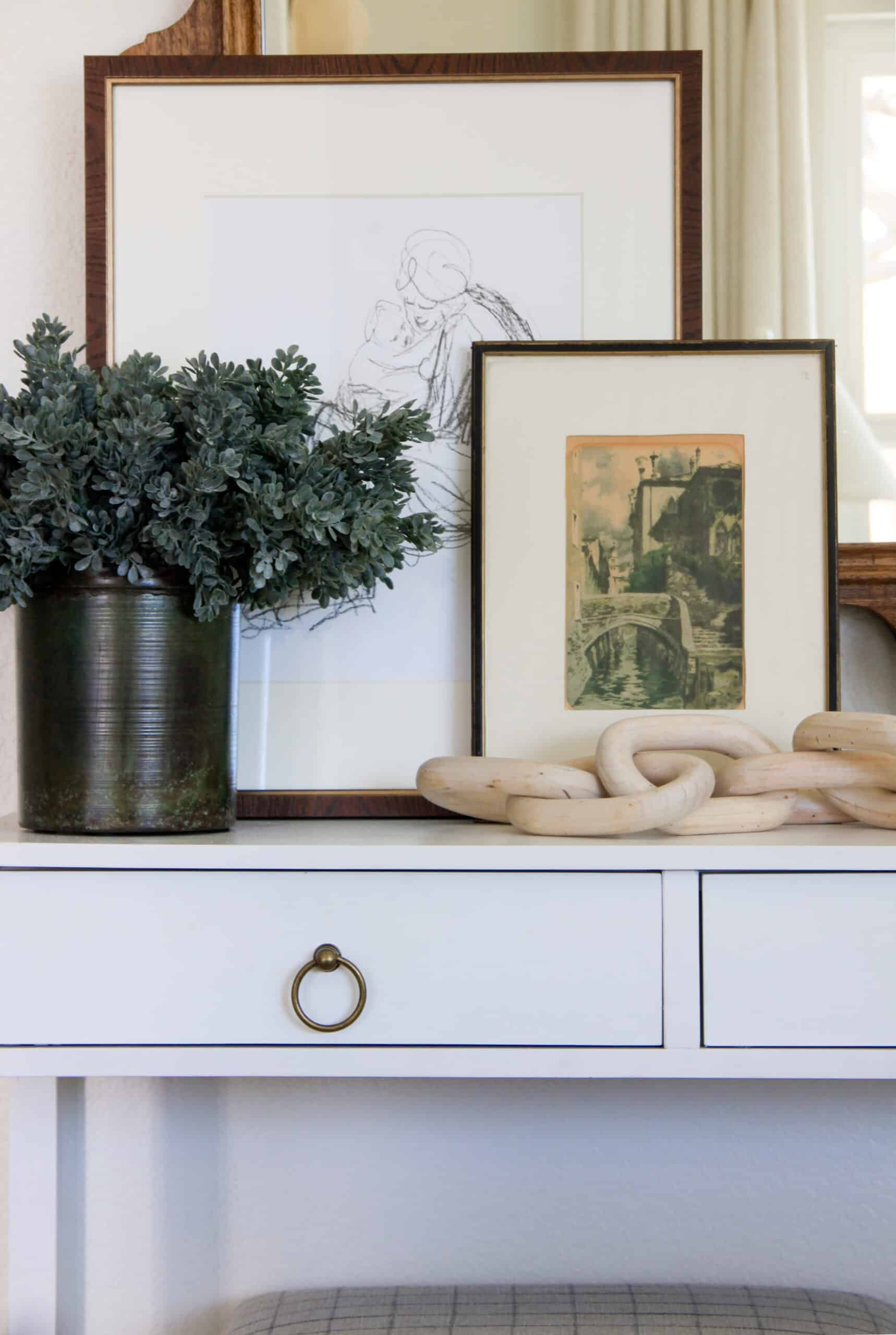 closeup of figure drawings and styled console table