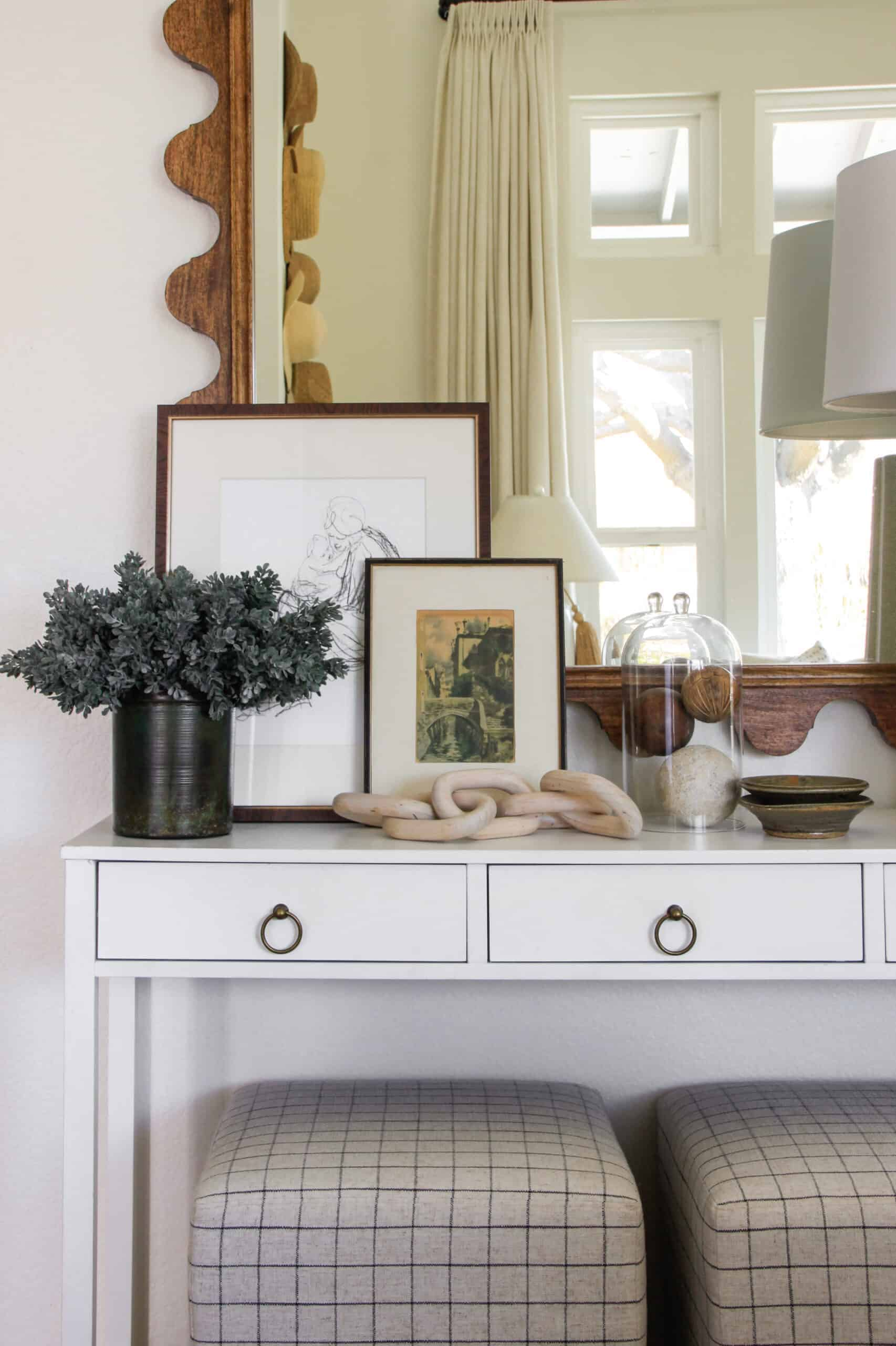 console table with figure drawings styled