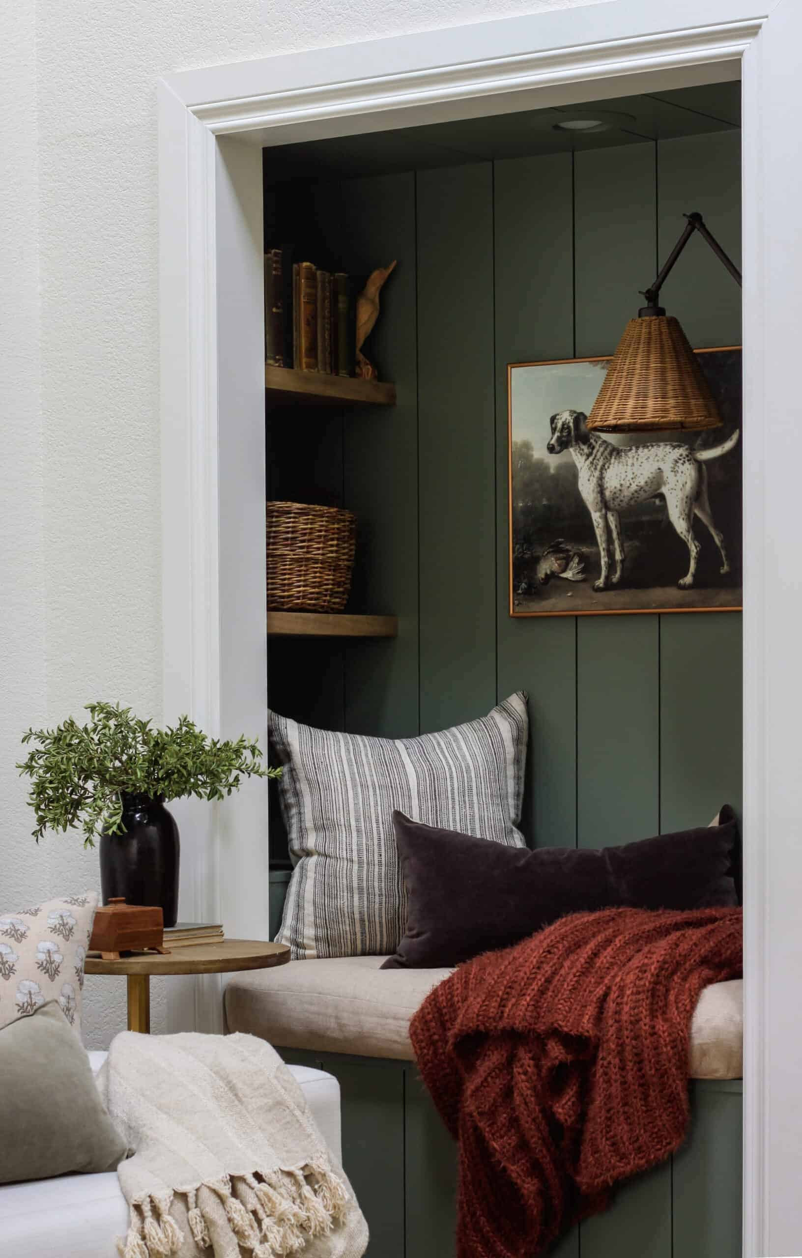 green shiplap reading nook with rust blanket