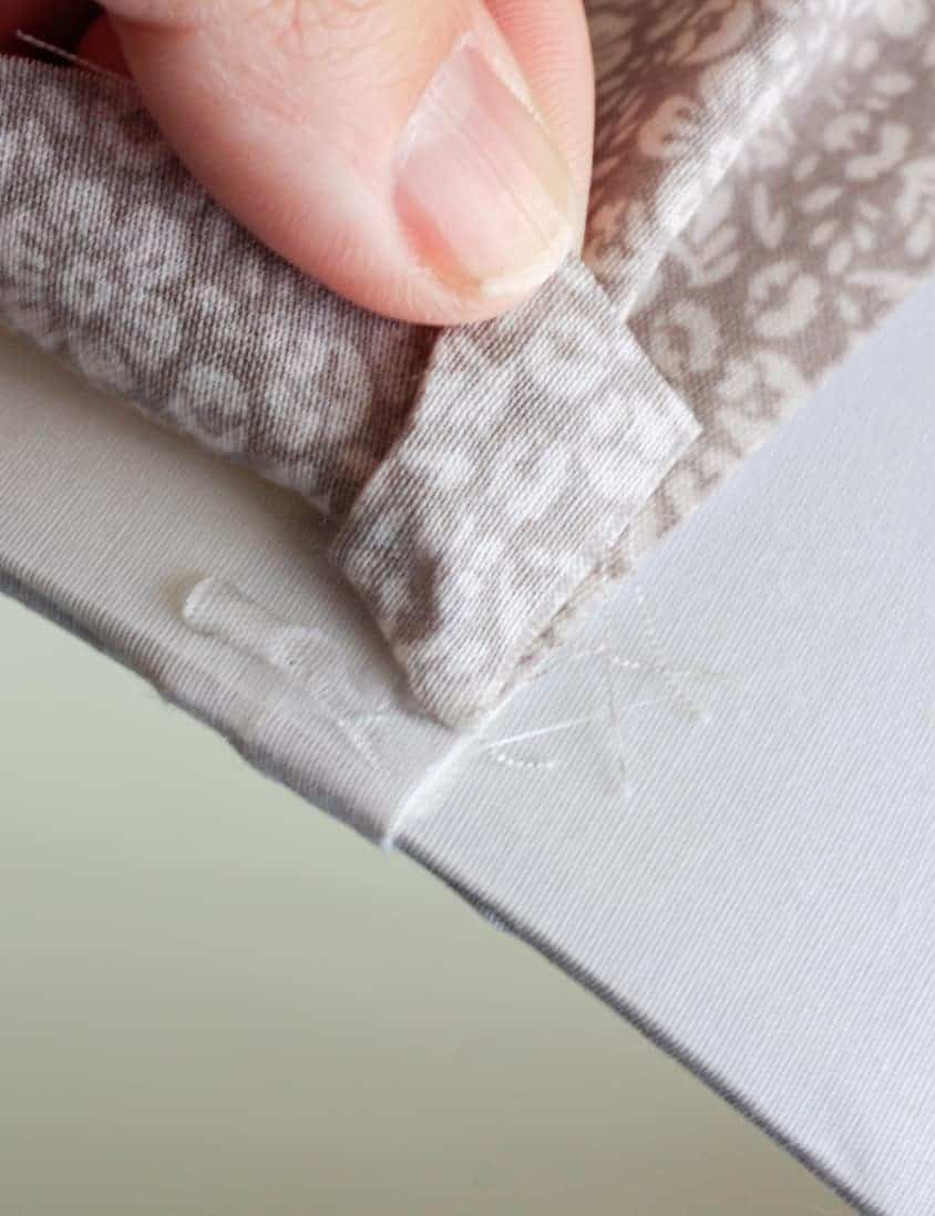 Hot glue underneath fabric on a lampshade