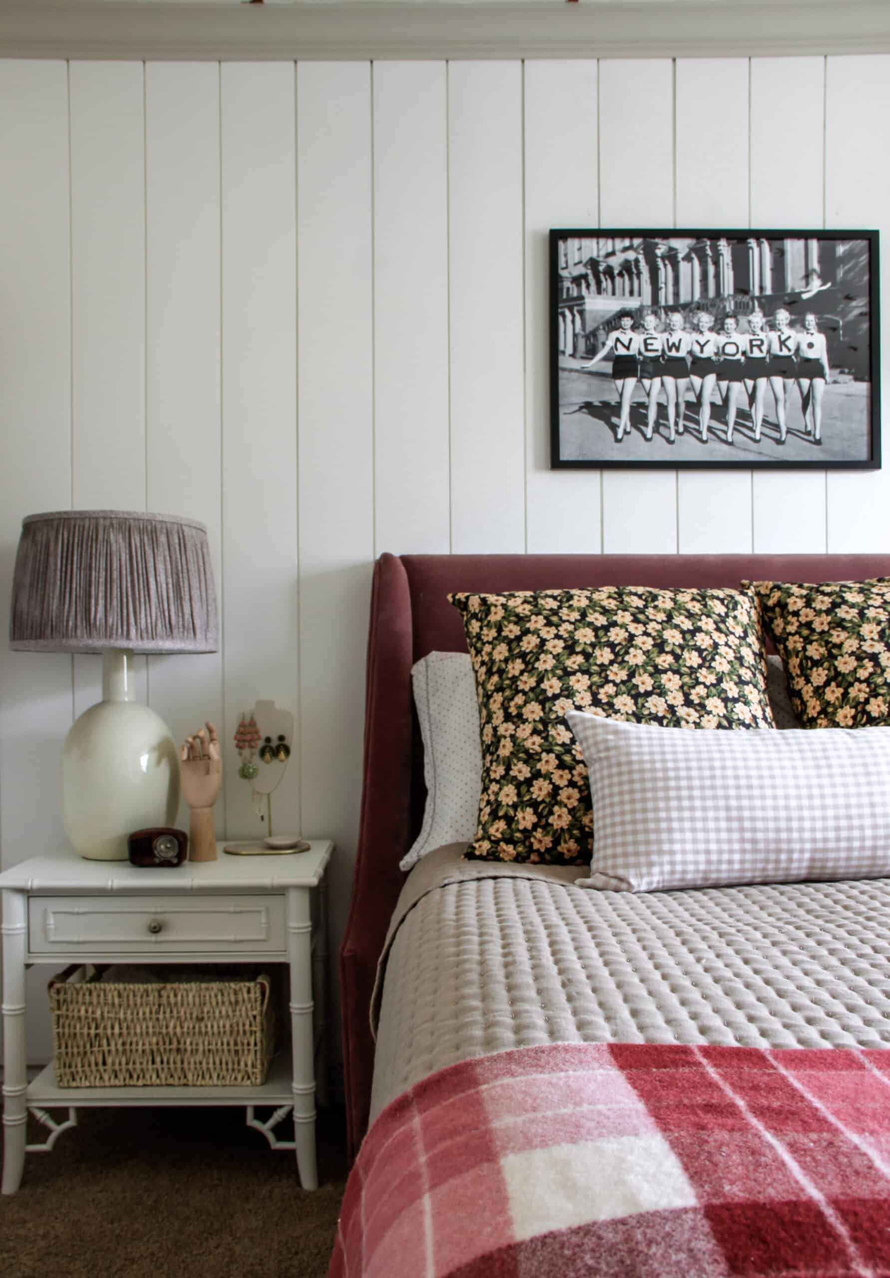 plum velvet bed with nightstand and pleated lampshade