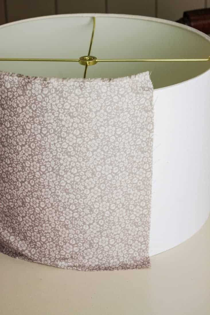 Lampshade with fabric attached to the back