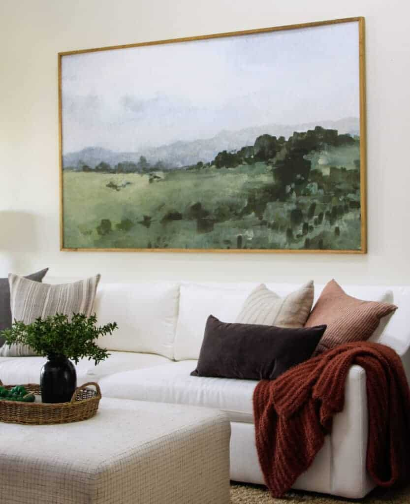 family room with white sofa and large artwork